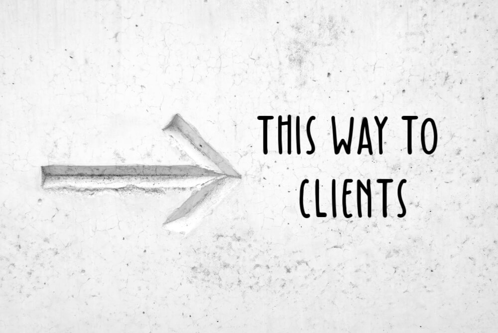 This is a concrete sign with an arrow to the right stating this way to clients ala freelance leads