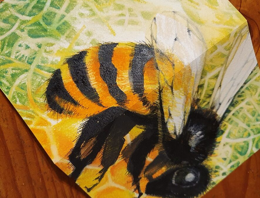 A bee is on a card it is by Lynore Avery to signify freelance activism
