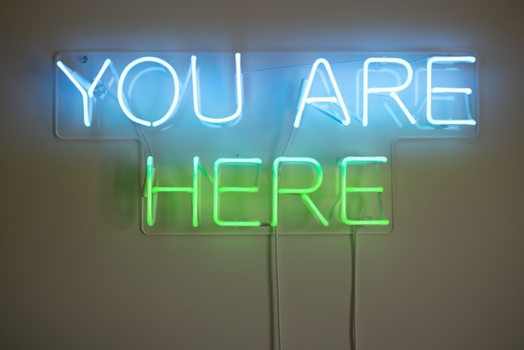 Encouraging people to practice being present with a neon sign that reads you are here
