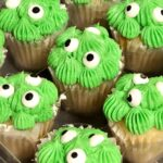 Cupcakes with bright green icing and 3 googly eyes on each.