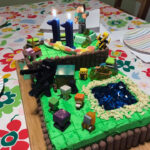 A large rectangular cake decorated in a Minecraft theme