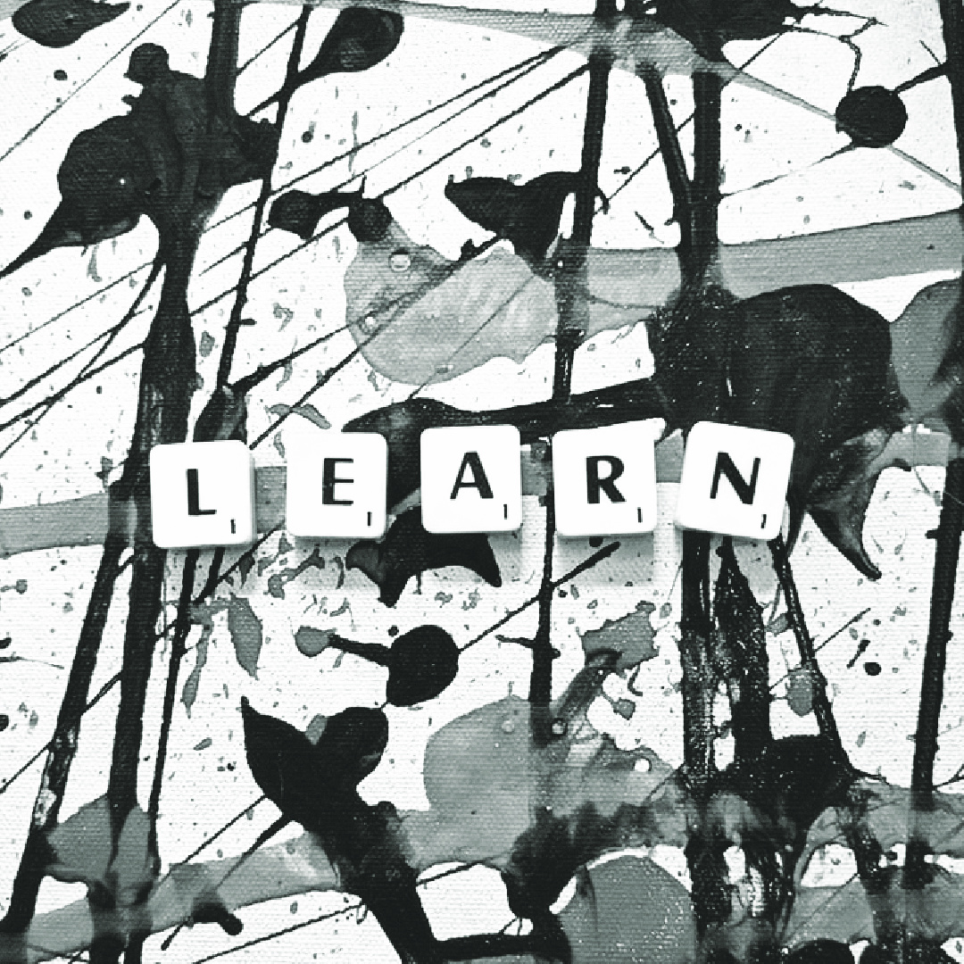 One a painted canvas, the word learn is spelled out in tiles
